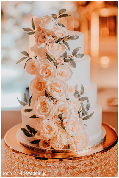 Peach roses decoration for Indian wedding cake.