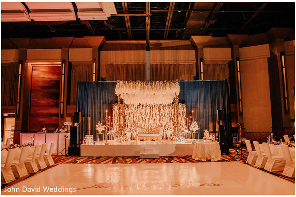 Ivory Indian wedding reception stage decorations.