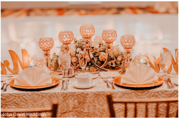 Indian couple's wedding reception bronze and ivory table decor.