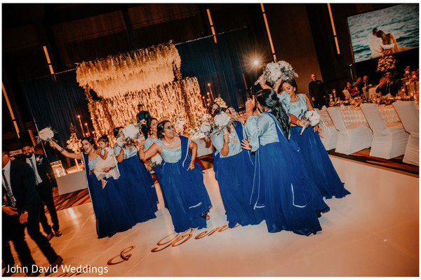 Indian bridesmaids on blue saree's at reception party.