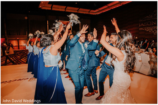 Indian couple's entrance at reception dance floor.