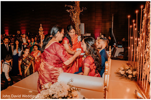 Indian bride and groom at reception wedding ritual.