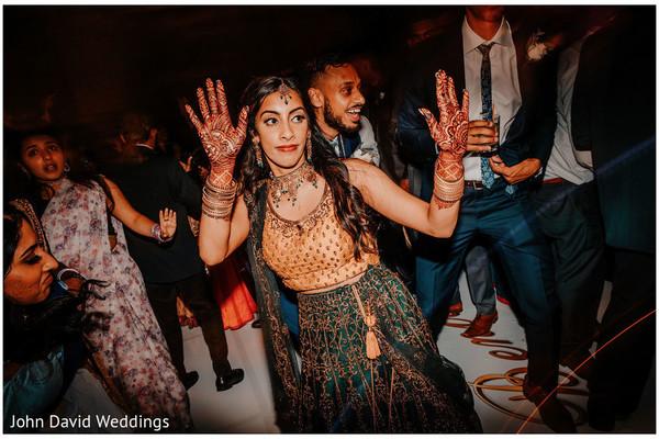 Indian bride dancing at Sangeet.