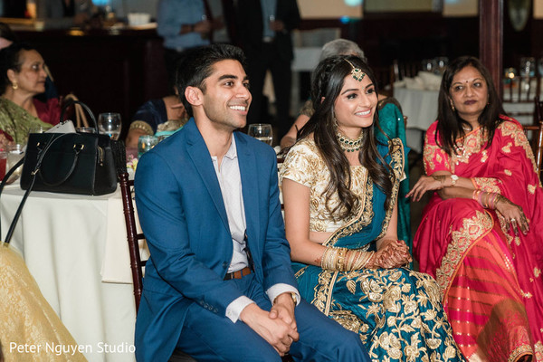 Indian newlyweds smiling during reception