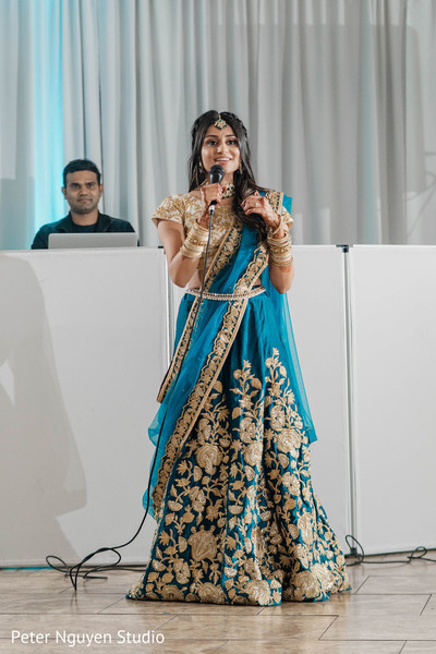 Indian bride speaking at reception