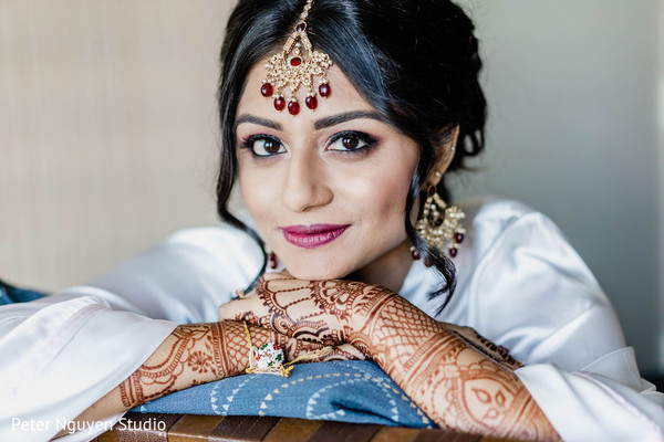 Indian bride with her hair and makeup done for ceremony.