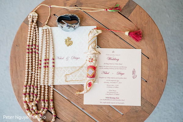 Red, Ivory and golden goom's jewelry and invitations.