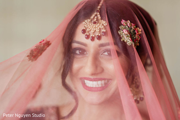 Indian bride with her red ghoonghat.