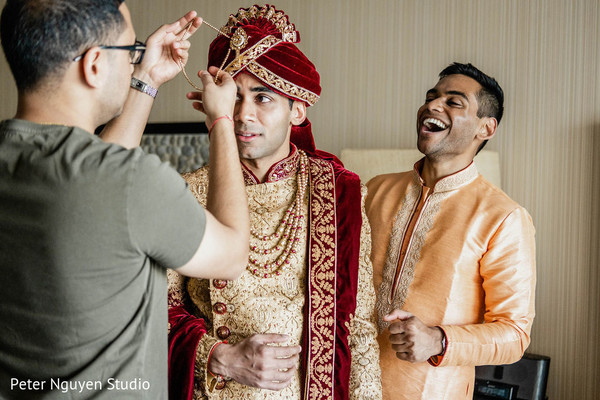 Indian groom getting his red turban on.