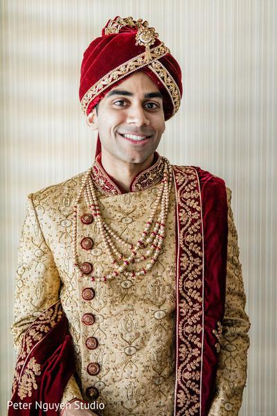 Raja posing in his wedding ceremony sherwani.