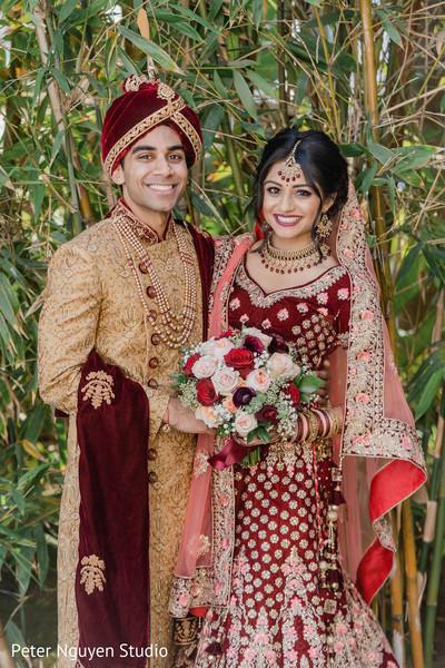 Indian birde and groom smiling capture.