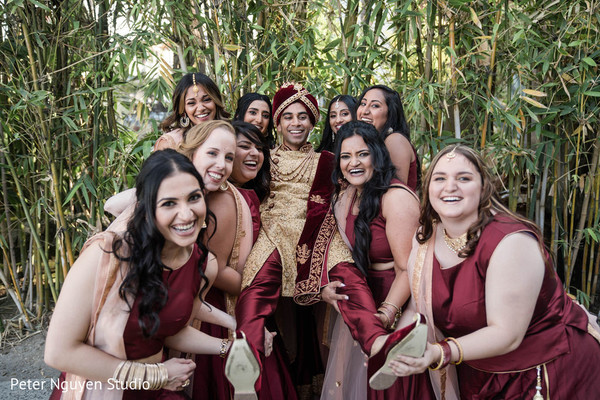 Indian groom with bridesmaids photo session.