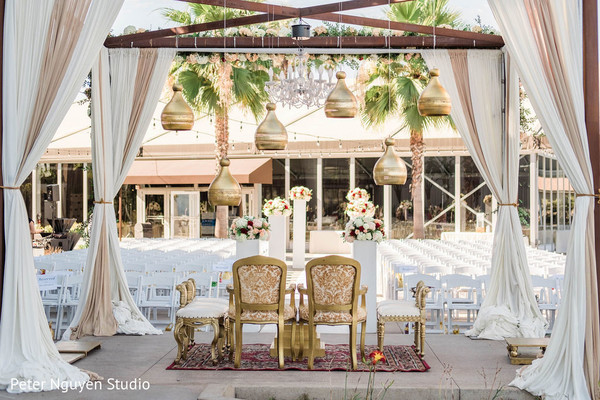 Golden and white indian wedding mandap decorations.
