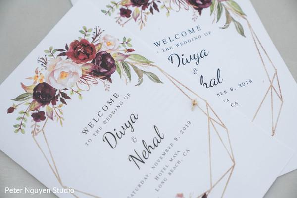 Flowers decorations on indian wedding invitations.