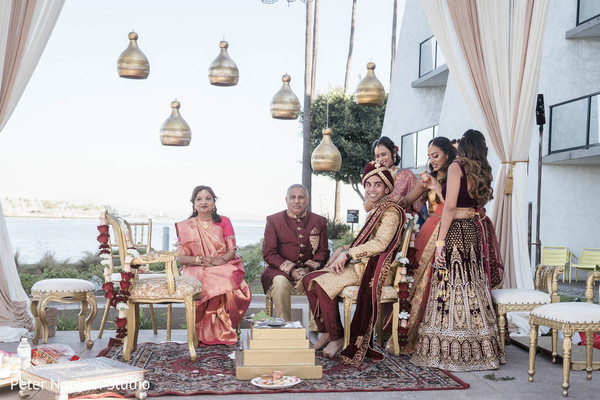 Indian broom being welcome to ceremony mandap.