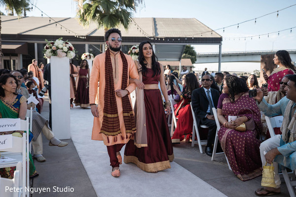 Indian bridesmaid and groomsmen walking down the aisle.