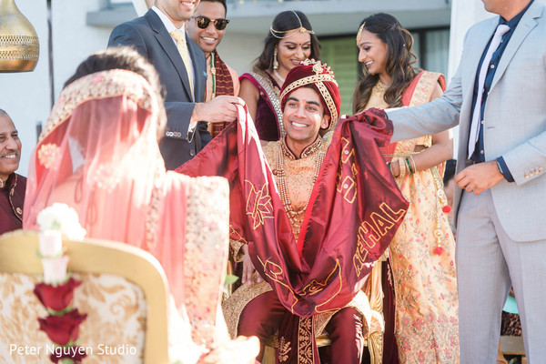 Indian groom uncovered to look at his bride capture.