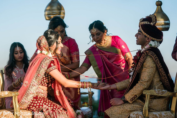 Indian bride and groom with lasso at wedding ceremony.
