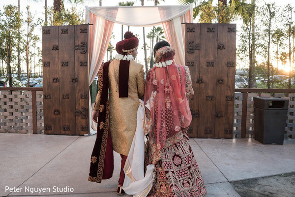 Indian bride and groom walking out of ceremony.