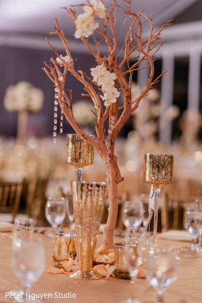 Indian wedding table golden decorations.