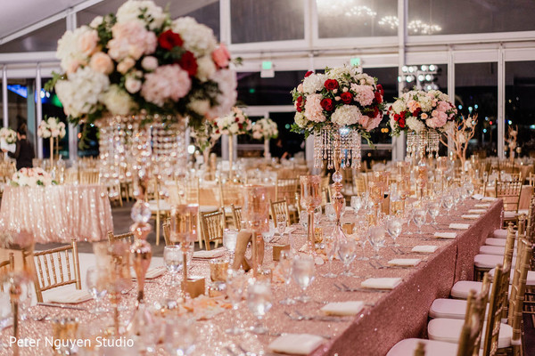 Golden  Indian wedding reception rectangular table decoration.