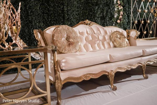 Indian wedding ivory and golden sofa decoration.