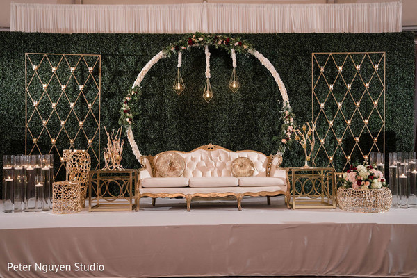 Green background for Indian wedding reception stage decoration.