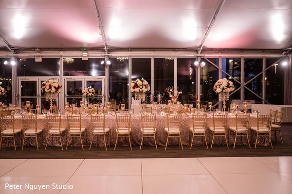 Indian wedding reception rectagle table setup.