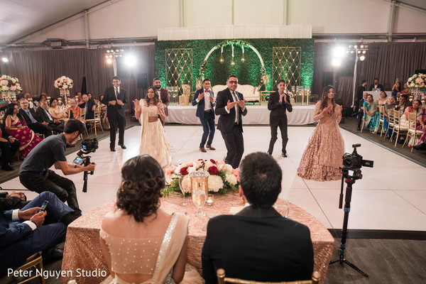 Indian groomsmen and bridesmaids performing a choreography
