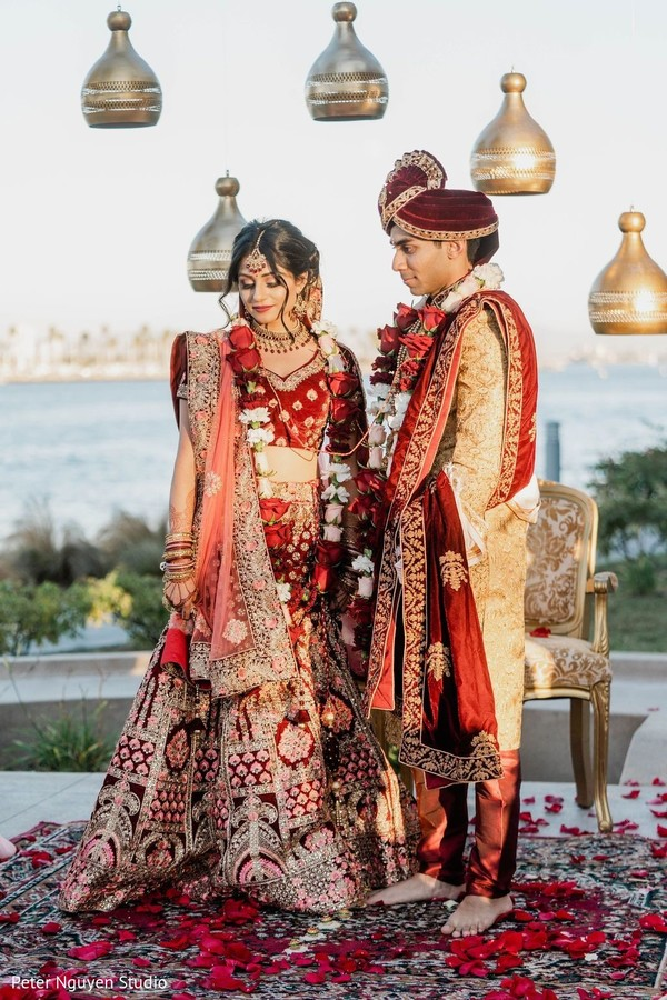 Maharani and Raja posing on their wedding ceremony outfits.