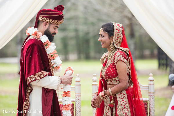 Lovely Indian bride and groom looking at each others capture.