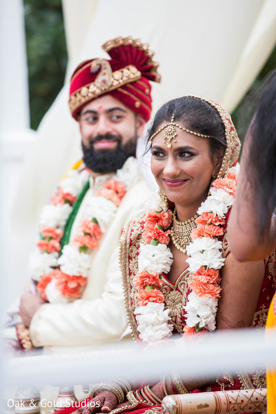 Lovely Indian wedding couple smiling.