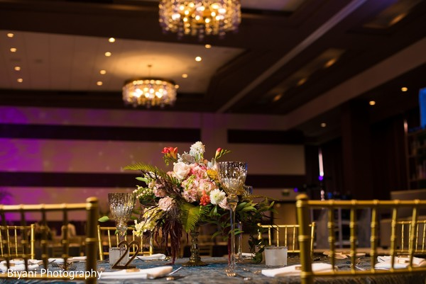 Indian wedding reception table centerpiece with flowers decoration.