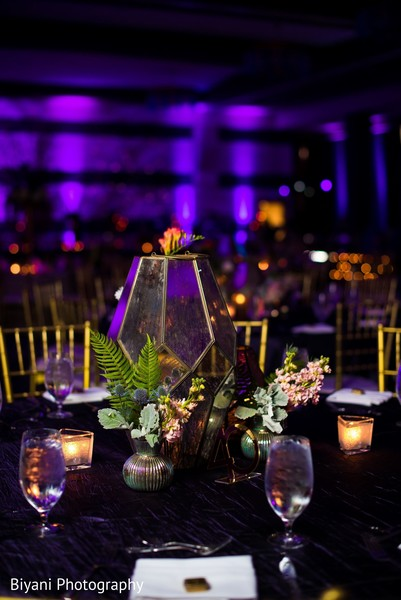 Indian wedding reception table lantern centerpiece decoration.