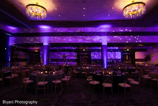 Indian wedding reception  purple lights decorations.