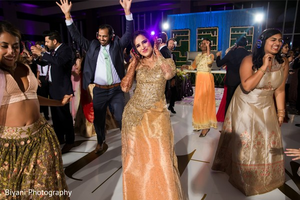 Indian wedding reception dance capture.