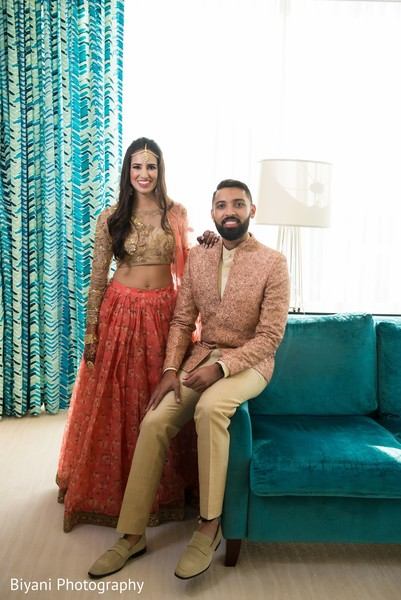Indian couple posing with pre-wedding outfits.