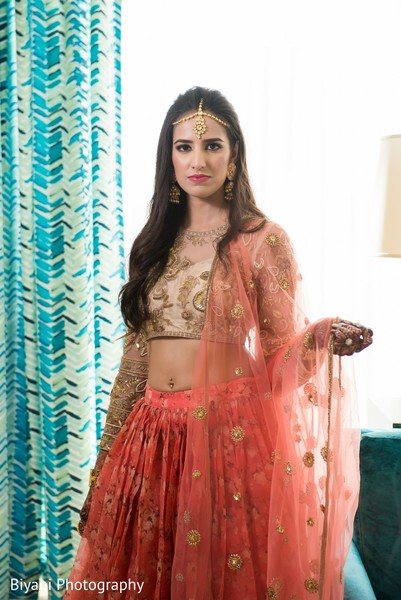 Indian bride with her pre-wedding outfit.
