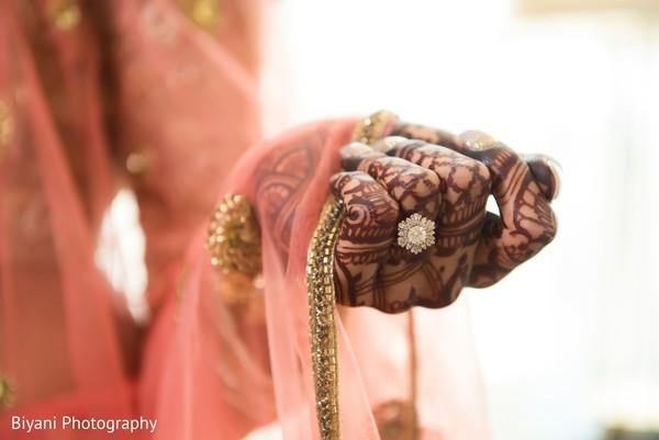 Indian bridal mehndi art and diamond engagement ring.