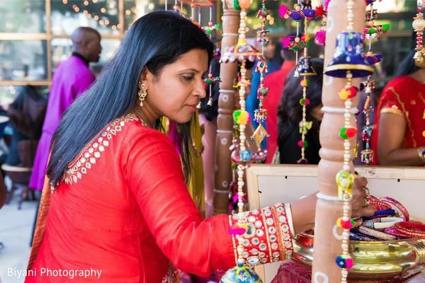 Indian Sangeet guest choosing favors.