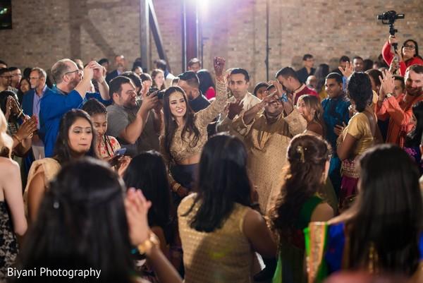 Indian bride at sangeet dance celebration.