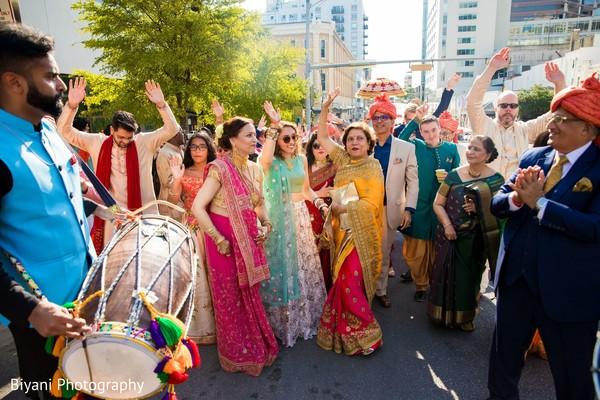 Outdoors Indian wedding baraat procession.