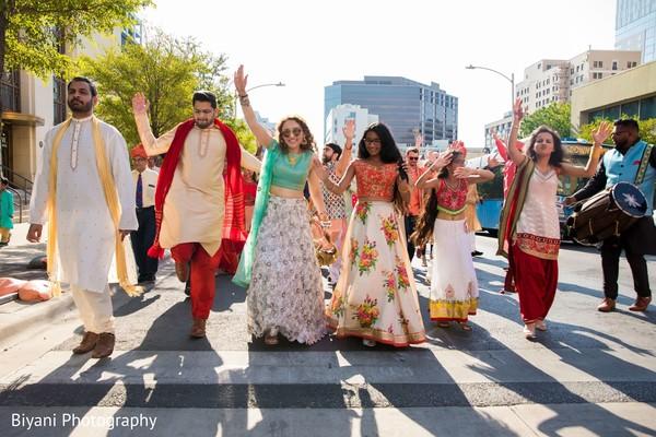 Indian bridesmaids and groomsmen at baraat procession.