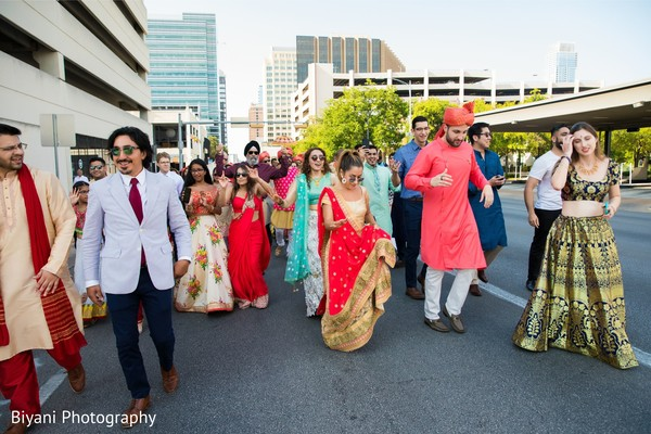 Indian wedding guests outdoors at baraat procession.