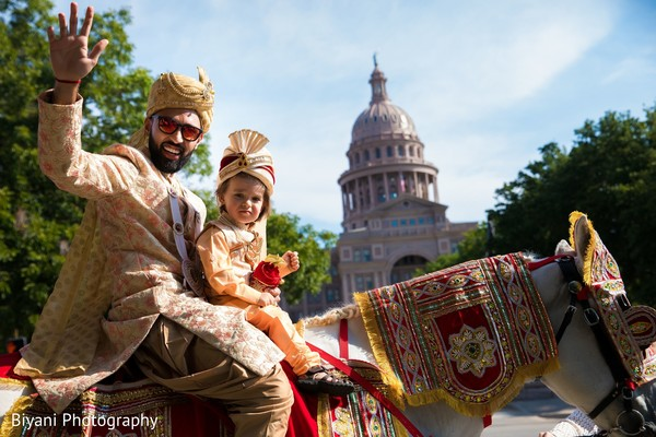 Raja with page boy on a baraat white horse.