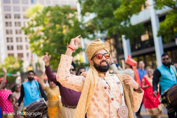 Raja at baraat procession in his ceremony outfit.