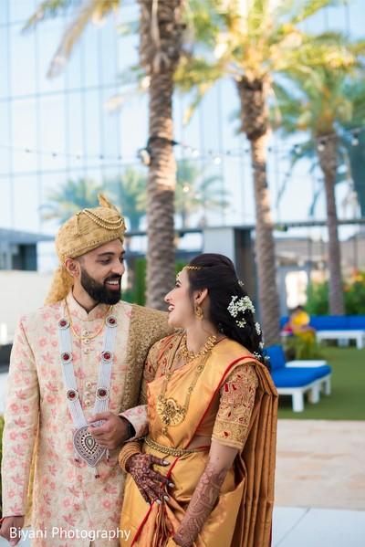 Joyful indian couple side by side.