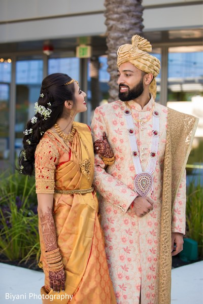 Indian bride and groom on their south indian wedding outfits.