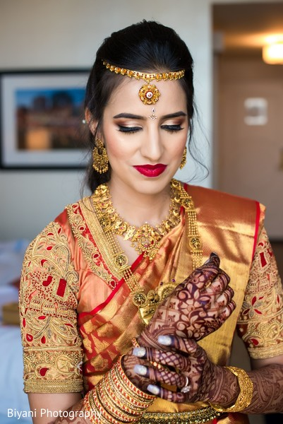 Indian bride putting one her chooras.
