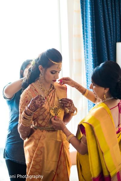 Maharani getting her jewelry on.